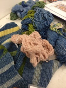 Examples of yarns which have been dyed using the woad plant.