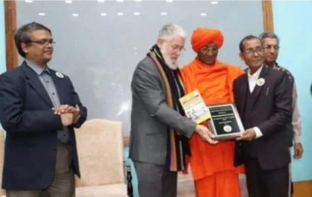 Deepak receiving award