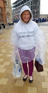 Photo of Pauline Wigglesworth in the rain wearing a HeadStart Blackpool sweatshirt