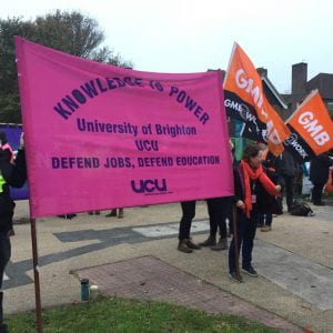 UCU members holding banner to support Hands Off Moulsecoomb Primary!
