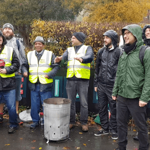 Staff standing near brazier on picket line