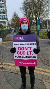Student on picket line holding 'Don't Cut IT' placard