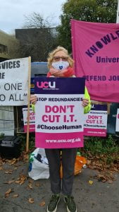 Staff on picket line holding 'Don't Cut IT' placard
