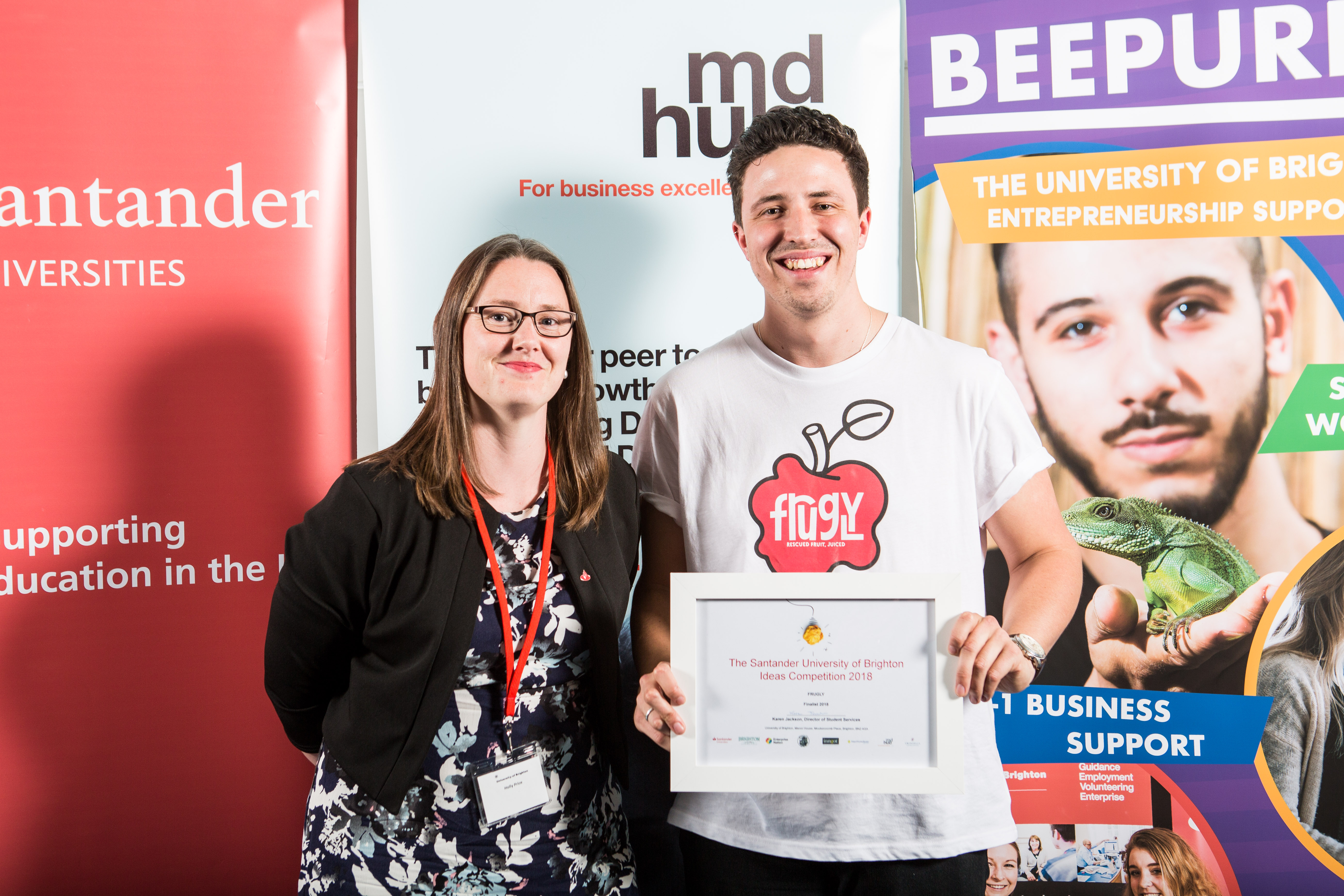 picture of Santander Universities' Holly Price presenting first prize to Harry Kimberley-Bowen