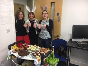 staff dressed up in bunny ears