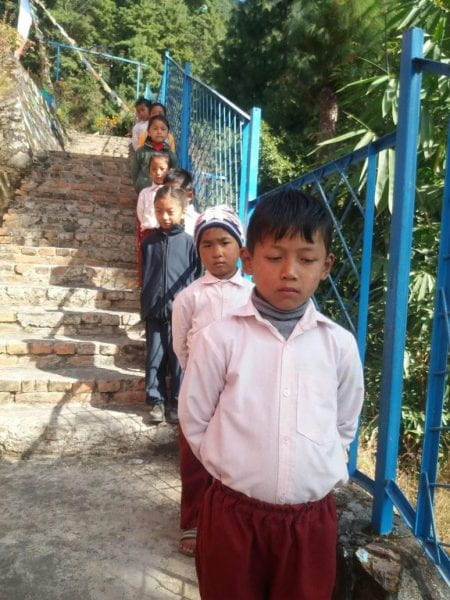 the children lining up to go to into the school