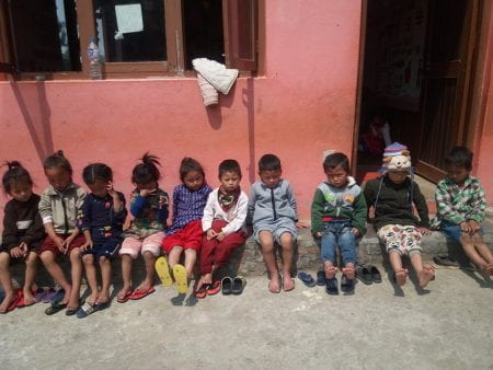 the children drying their feet in the sun