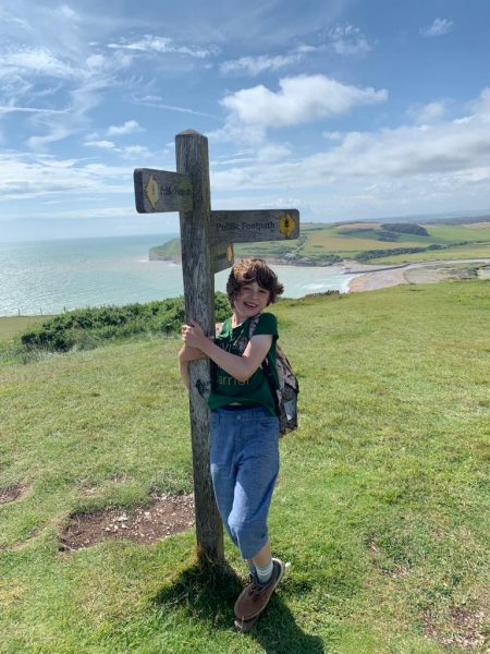 Benji next to the South Downs Way sign