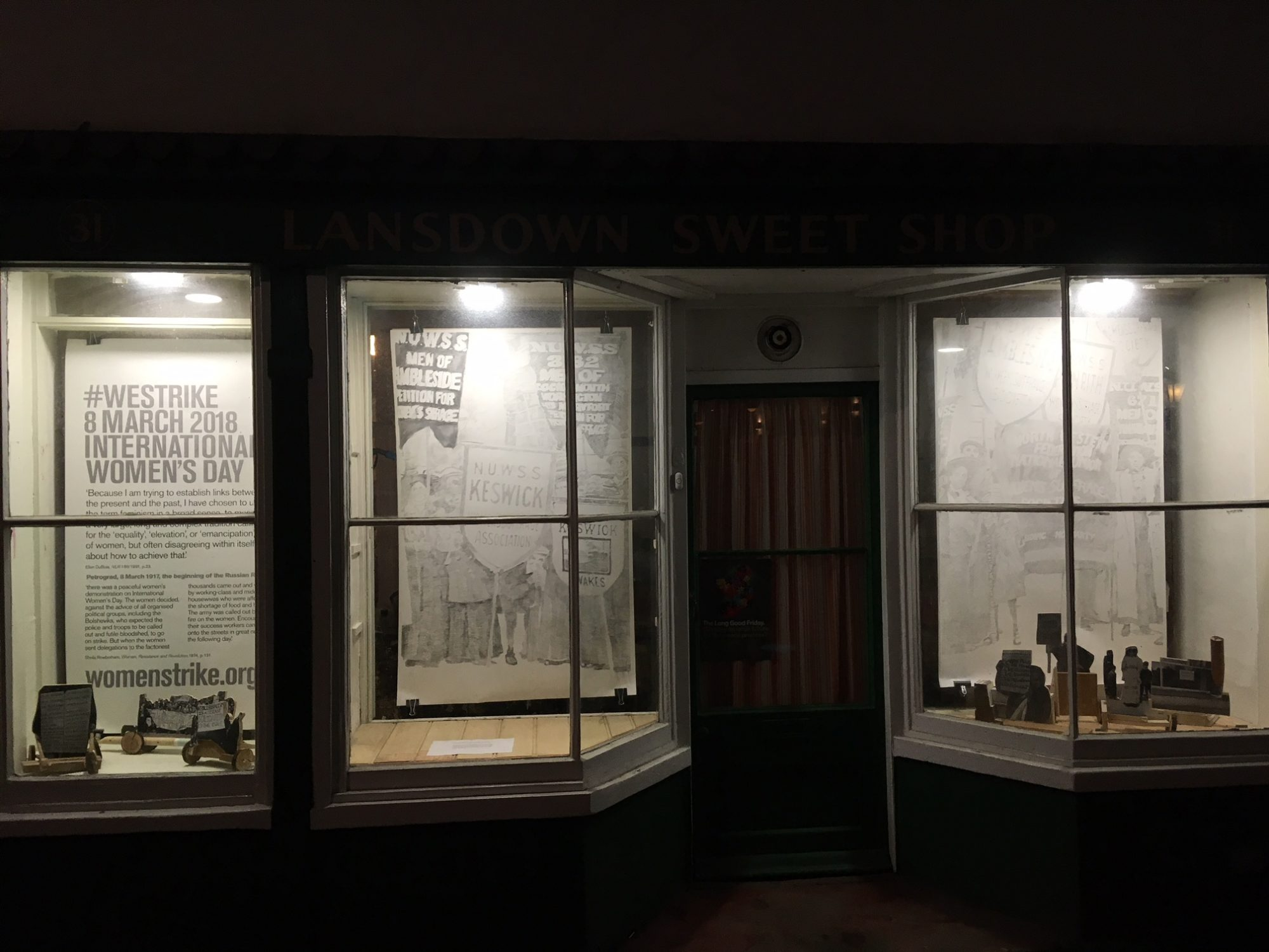 sweetshop windows at night