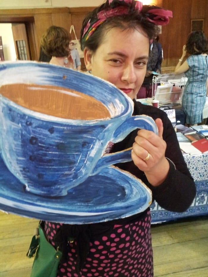 Sophie Herxheimer holding a huge tea cup