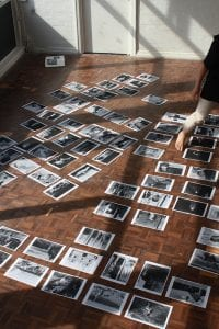 photographs arranged on studio floor