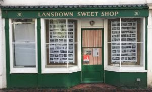 sweetshop front with posters
