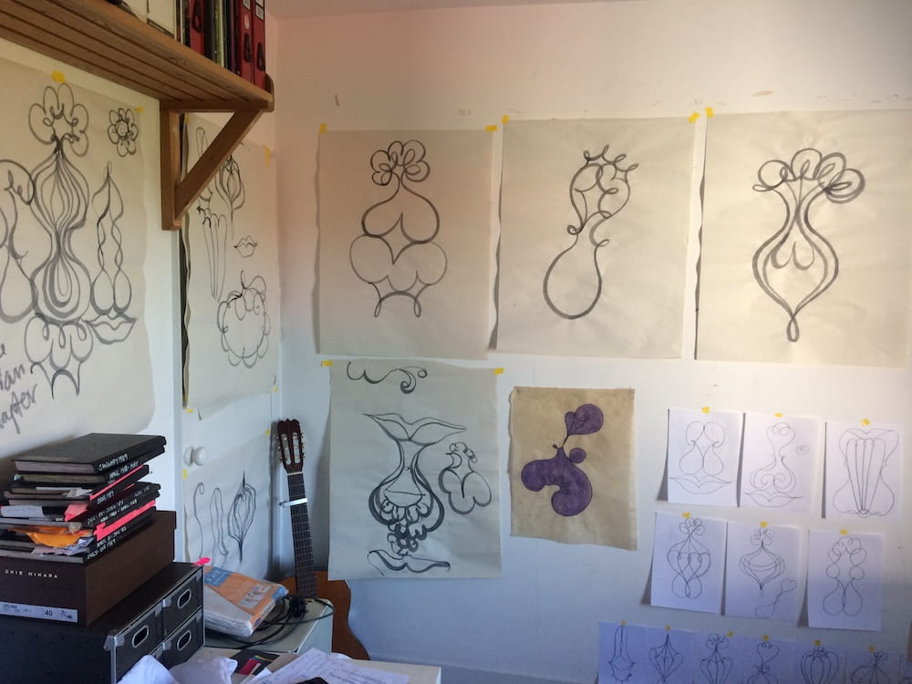 studio wall with drawings on it