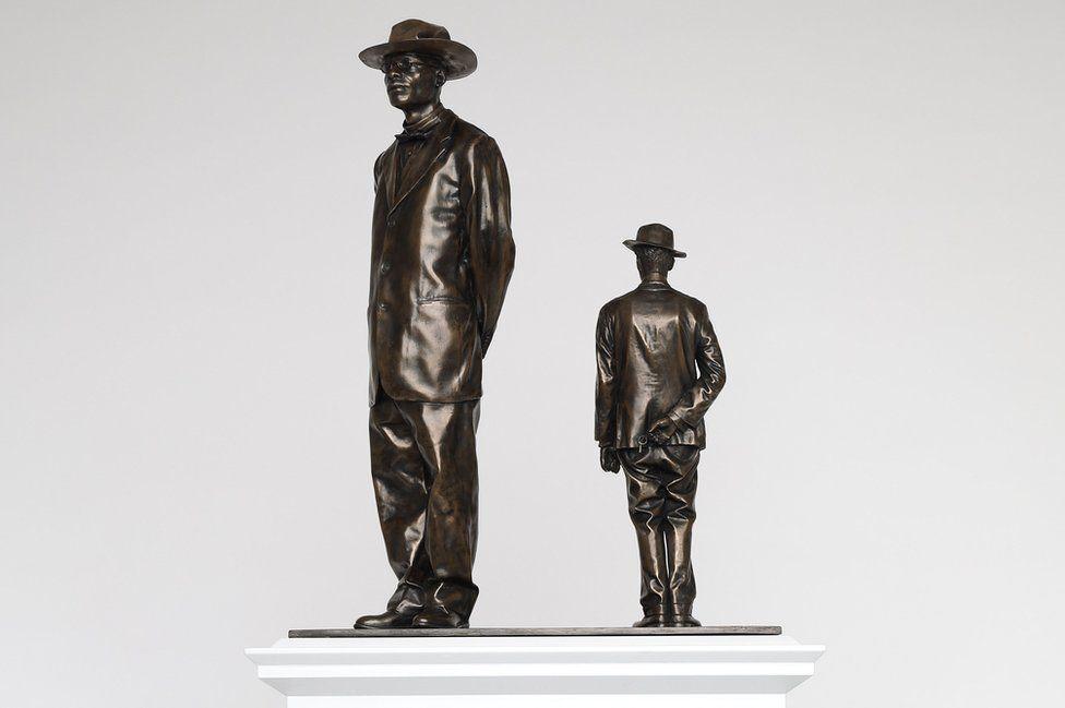 two bronze statue