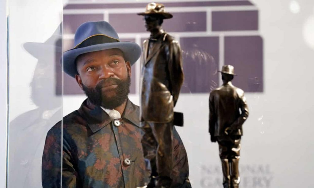 Artist Samson Kambalu with a model of his planned fourth plinth sculpture