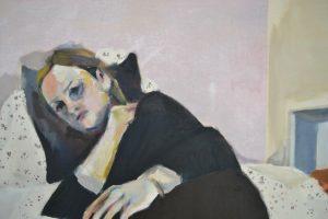 Sara Lavelle figure on sofa