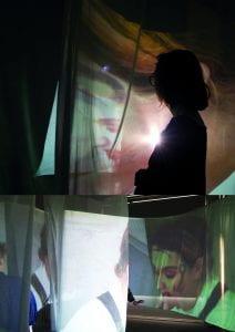 Image of figure against lit backdrop