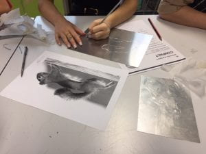 Image of hands doing printmaking