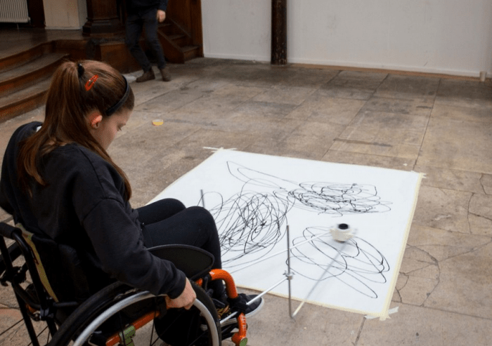 wheelchair user using the enayball