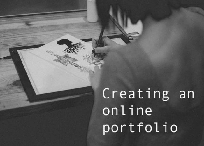 person working with 'creating an onlne portfolio' text
