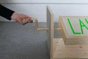 Hand turning a wooden crank