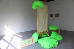 Green soft formsdraed around a wooden structure