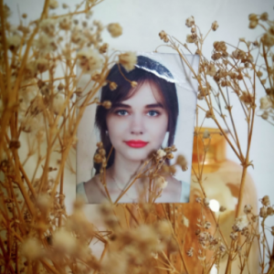 photo of woman behind plants