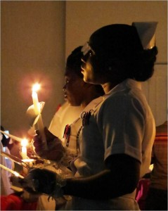 Nurses held candles to light the way for patients' recovery