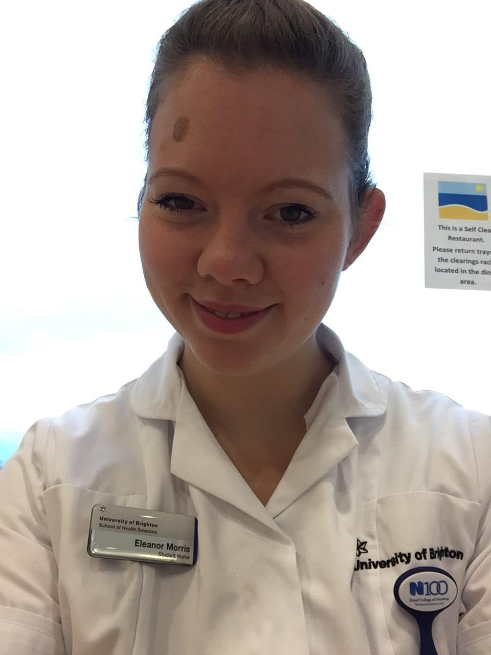 A siling Ellie Morris in her nursing uniform