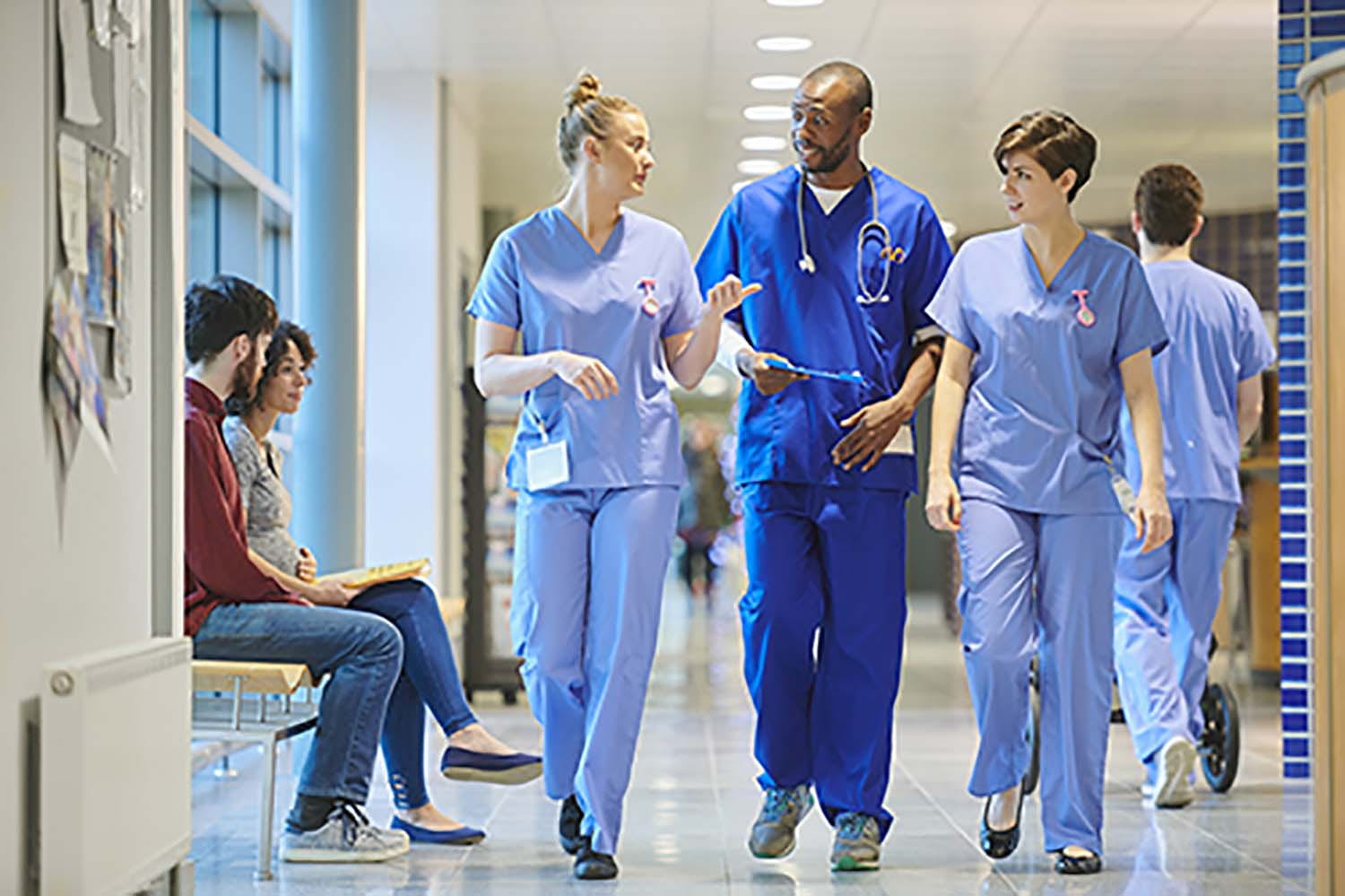 students walking down a hospital corridor