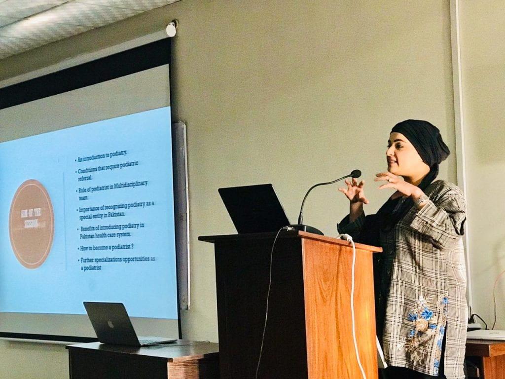 Humeira giving a presentation