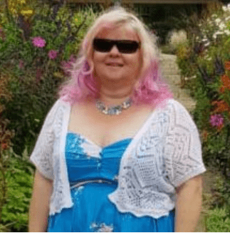 Dr Angie Hart in her garden wearing sunglasses