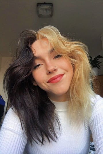 A photo of Charli smiling