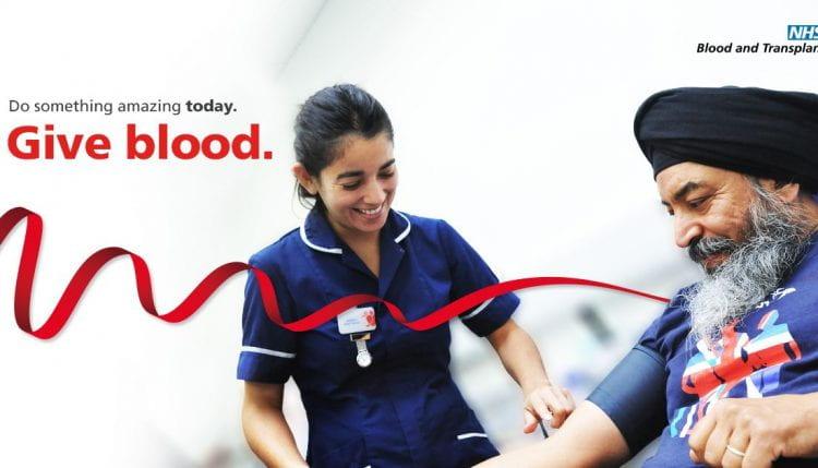 image of a nurse taking blood