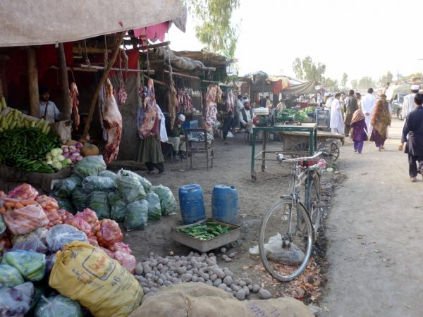 colour photograph of a food market in the Shamshatoo refugee camp in Peshawar
