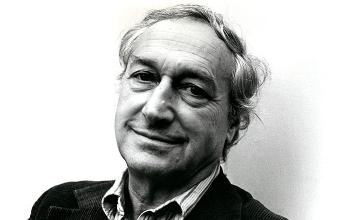 Black and white portrait of FHK Henrion smiling at the camera