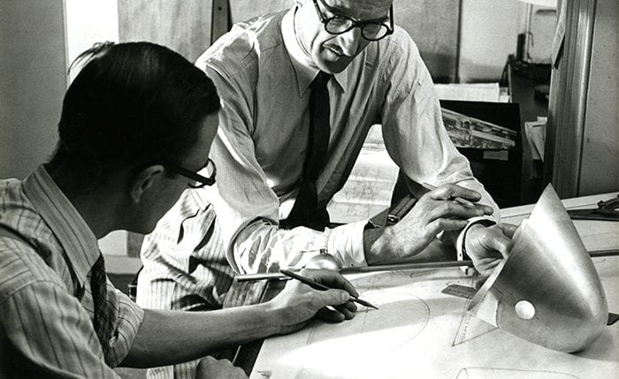Black and white photo of A.B. Read with a colleague by a drawing table