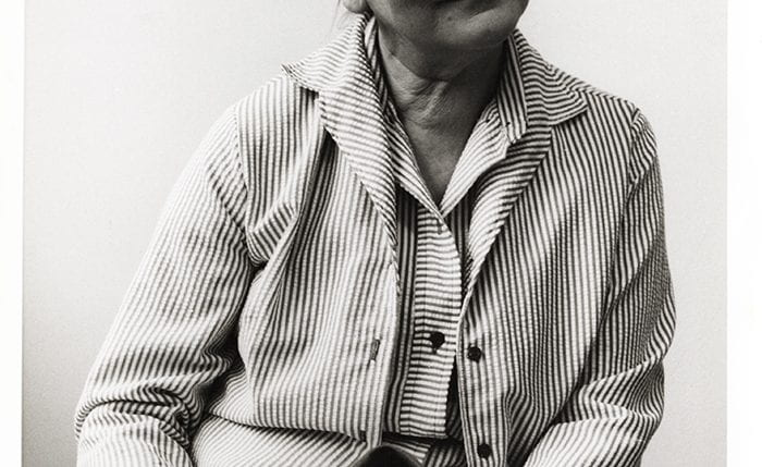 Black and white portrait of Marianne Straub in a stripey shirt and jacket