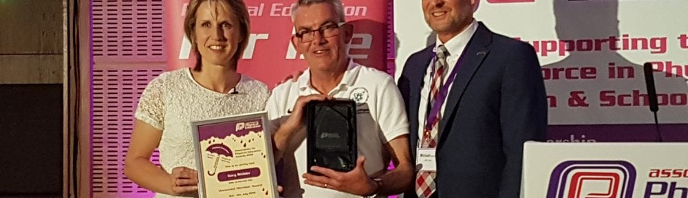 Dr Stidder with his award