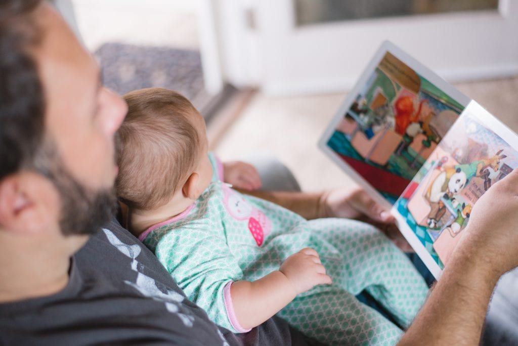 A dad reading with his child