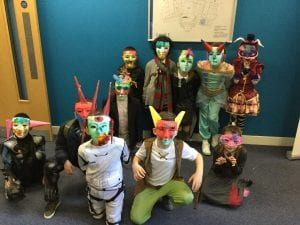 Children wearing the facemasks they made at the university