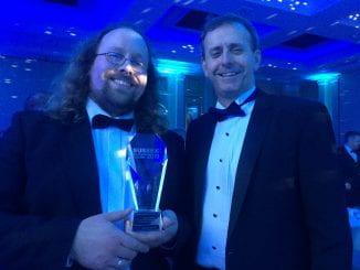 Michael with head teacher Chris Pearson and his award