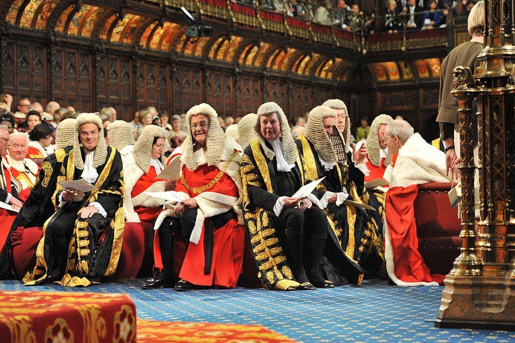 Members of the judiciary in the Lords chamber ahead of the Queen's Speech 2013. Credit - Houses of Parliament, Flickr