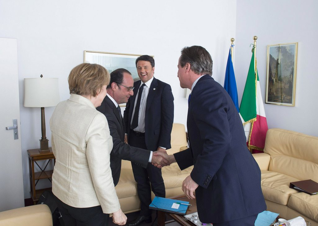 L-R: German Chancellor Angela Merkel, President of France Francois Hollande, President of Italy Matteo Renzi, United Kingdom Prime Minister David Cameron. Brussels, April 2015. Credit - Palazzo Chigi, Flickr.com