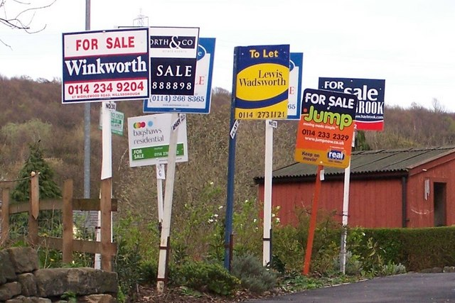 House For Sale Signs on River Bank, viewed from Low Road, Oughtibridge. Credit - Terry Robinson/Geograph.org.uk