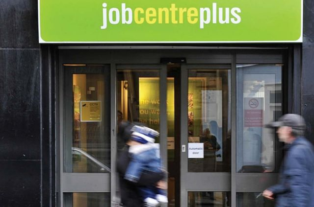 An image of people walking past a job centre plus