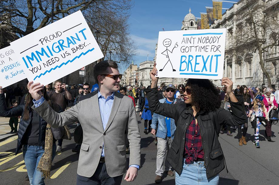 People on a march with Brexit signs
