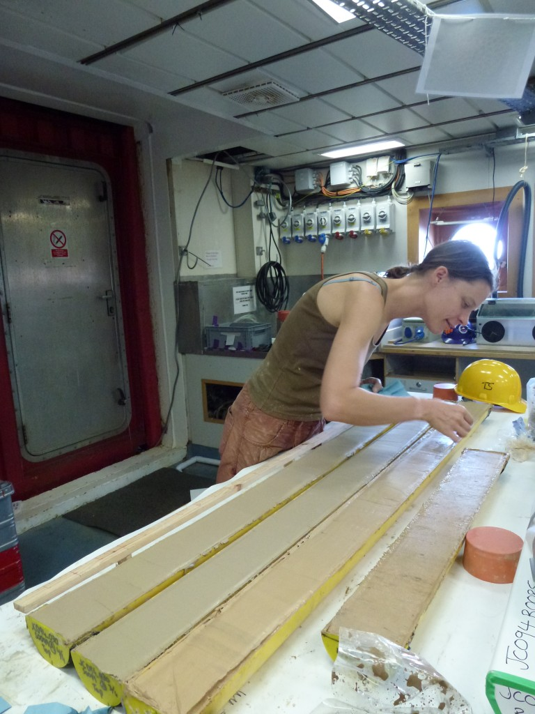Veerle carefully polishing the sediment cores. Photo by: Melanie