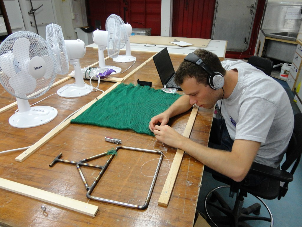 Pete's sewing in action (making nets to collect deep sea corals)_HC Ng