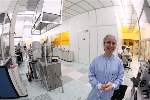 Döndü  in the 'cleanroom': researchers must wear special, dust-free covers not to introduce particles or dust to the environment.